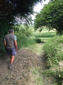 Our farmer, Robert, taking us down leafy paths to the strawberry, blackcurrant and gooseberry fields